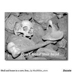 Skull and bones in a cave. Don't loose your head. Postcard