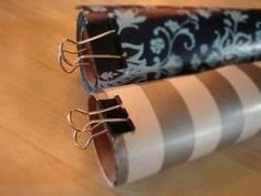 Wrapping Paper Organizer | Community Post: 54 Uses For Binder Clips That Will Change Your Life