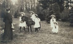 All the Romanovs were fond of photos. This postcard shows Empress Alexandra Feodorovna (left) standing, holding a camera and facing her children. The children are (left-right) Grand Duchess Olga, Grand Duchess Anastasia (on top of a Shetland horse), Grand Duchess Tatiana, Grand Duchess Marie and Tsarevitch Alexei. This postcard was sent by her to her cousin, George, Prince of Wales (future George V) as a Christmas and New Year card for 1906/1907.