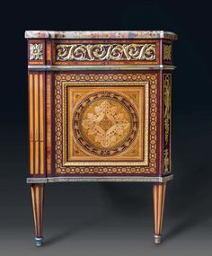 """IMPORTANT COMMODE """"L'ALLEGORY DE LA MUSIQUE"""", Louis XVI, signed N. LANNUIER (Nicolas Louis Cyril Lannuier, maître 1783) and labeled """"marchand mercier"""" Paris about 1785. tulipwood, purple heart and various exotic woods, exquisitely inlaid with central medallion after F. BOUCHER (1703 Paris 1770); Front with 2 sans traverse drawers below 3 Adjacent drawers. Fine matte and polished gilt bronze mounts and sabots. Shaped """"Brèche d'Alep"""" top. 130x59x85 cm. Provenance: - formerly Dubois Chefdebien…"""