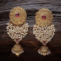 Designer earrings studded with synthetic ruby stones and beads, plated with gold polish and made of copper alloy! Indian Jewelry Earrings, Indian Jewelry Sets, Jewelry Design Earrings, Indian Wedding Jewelry, Gold Earrings Designs, Antique Earrings, Ear Jewelry, Bridal Jewelry, Designer Earrings