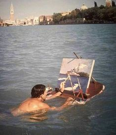 Salvador Dali painting while swimming in Venice, Italy. 1947. Salvador Dali Paintings, Holiday Sales, Pictures To Paint, Painting Pictures, Bath Caddy, Summer Vibes, Location History, Beach Mat, Outdoor Blanket