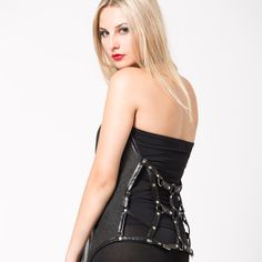 Woman black knitted harness vest. $80.00, via Etsy.