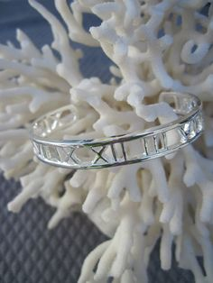 "{     name: 'Date Cuff',     price: 80,     description: ""Your children's birthdays in Roman numerals "",     photoURL: ""URL"" },"