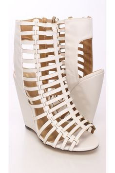 Rev your style up with these simple yet edgy wedges! This style goes great with your fave skinnies, a chic crop top and finish with a spike necklace. Featuring crinkle faux leather upper, peep toe, strappy cutout, side zipper closure, cutout heel, stitched detailing, smooth soles, and finished with a cushioned footbed. Approximately 4 inch heel.