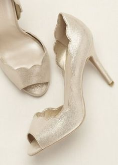 Complete your look with these stylish and feminine scalloped edge peep toe pumps! @weddingwire