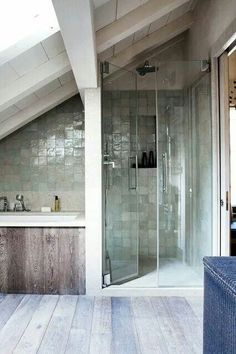 Love the tiling in the shower as well as the glass doors, and the wood gives it a nice, rustic feel.