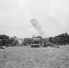 Churchill AVREs of 79th Assault Squadron, 5th Assault Regiment, Royal Engineers, and other vehicles on Queen Red beach, SWORD Area