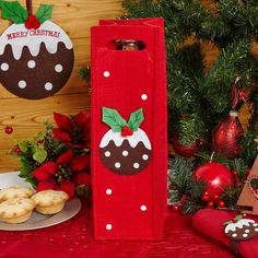 Christmas Pudding Felt Bottle Bag - Gift wine bottles in style with this bright and bold bottle bag, part of our range of felt decorations, tableware and accessories. Featuring a holly-topped Christmas pud on a vibrant red background, this bag is suitable for wine, beer or soft drinks, providing a stylish and more convenient alternative to gift wrap.