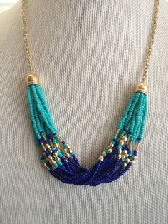 Gorgeous Statement Necklace Multiple strands of beaded chain in Lapis Blue, Turquoise and Gold. Beaded strands are finished on either side