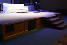 Front fill speaker and sub-woofer boxes installed under the stage at Emmanuel Community Church in Fort Wayne, IN