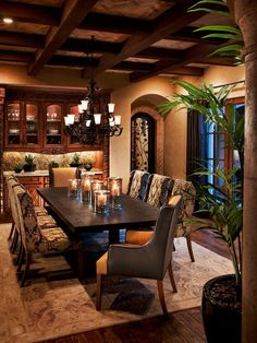 Rich, opulent dining room: dark wood, mixed fabric, box beam ceiling