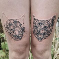 A pair of third eye kitties, one snarling, one skull.  thanks Izzy!