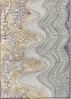 Kate Dowty. The quilting of the patterns with different colored thread make this quilt interesting to look at and does indeed give a sense of a beach with rocks and waves.
