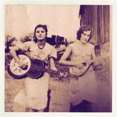 1930's gal playing dobro and mandolin