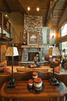 Beautiful fireplace in a rustic living room.  I said I never wanted high ceilings again, but this has my attention!