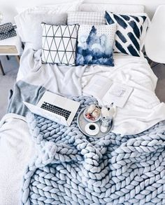 Dusty blue chunky-knit blanket and bedroom. All the good things.
