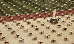 Nursing students take part in an open-air examination at a college in Baoji, Shaanxi province, China