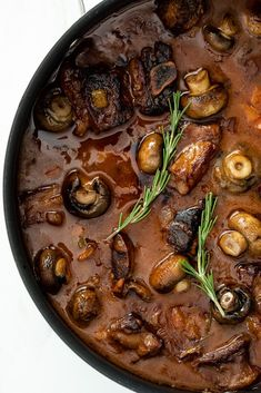 Slow braised beef short ribs in a rich gravy with mushrooms and herbs served with cheesy mash is the ultimate comfort food and perfect to make ahead. #shortribs #dinnerrecipe