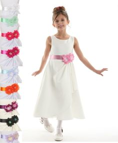 Brianna: Satin Ivory Flower Girl Dress with SashBrianna : Ivory Satin Flower Girl Dress This is a fully lined style that includes an attached under slip with soft satin lining and netting. The base color comes in white or ivory and you can choose your favorite bow tie ribbon in the color of your choice. This dress is designed and made in America.