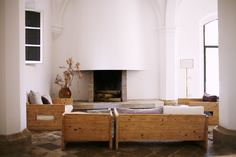 Custom sofas and chairs were designed using reclaimed materials by Demory.