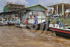 Exotic Floating village at Inle Lake, Myanmar and people on the boat.