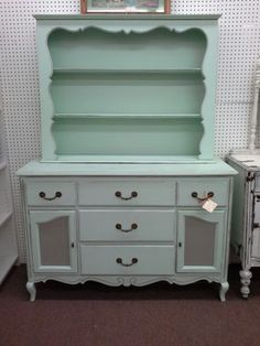 $250 - This is an elegant country French two piece china hutch. It has been painted a mint green with silver accents. Two piece construction make it easy to move. It measures approximately 52 inches across the front and 19 inches deep. Standing approximately 70 inches to the tallest point. It can be seen in booth D 2 at Main Street Antique Mall 7260 East Main St ( E of Power Rd ) Mesa 85207  480 9241122 open 7 days 10 till 530 Cash or charge 30 day layaway also available