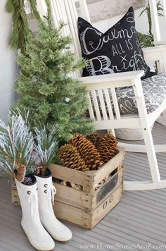 A porch vignette, decorated from head-to-toe in holiday decor. And loving the boots as planters!
