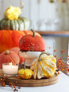 Create a great centerpiece with pumpkins piled high on bowls, plates and other decorative knick knacks.