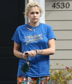 WHY SO BLUE?   Sporting a bright tee with her late father's name, Paris Jackson dresses casually to see a friend in L.A. on Sunday. Star Tracks: Monday, Feb. 20, 2017