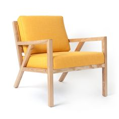 Inspired by the work of the Sarasota School of Architecture and at home in both modern and traditional spaces, this mid-century styled chair features a solid natural ash frame with an interlocking tru