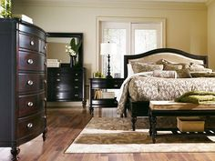 Copley Square  Copley Square    The rich coffee bean finish, turned legs, natural linens and custom designed satin nickel hardware hint at the West Indies influence. Each piece is made of birch wood and matching veneers to be as enduring as they are stylish.  Havertys