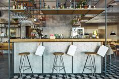 For Główna Osobowa Kitchen + Bar, PB Studio's main goal was to design an interior which would work equally well during daytime as well as late at night.