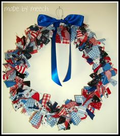 Patriotic Rag Wreath - It's pretty easy.  Just bend a wire hanger into a circle and tie lots of strips of fabric around the hanger.  The strips of fabric were 1 in. x 7 in.  I then added a bow and ta da!  Easy!