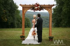 Married under a wooden arbor at the top of a ski run » Wendy Mitchell Photography | Buffalo Wedding Photography