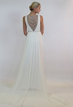 Brides.com: 25 New Wedding Dresses with Statement Backs. Wedding dress by Nicole Miller  See more wedding dresses from Nicole Miller's Spring 2015 collection.
