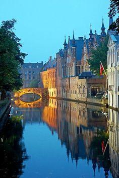 In reflective Bruges, Belgium.