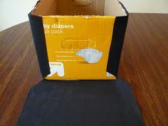Custom made storage box from cardboard box. So creative!