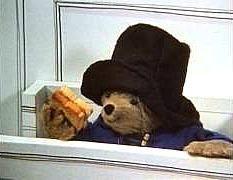 Paddington Bear eating a marmalade sandwich