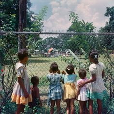 Gordan Parks | Black children looking in on a whites-only playground | Mobile, Alabama | 1956