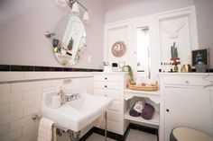 DIY Beauty Oasis Bathroom Makeover | The sink and vanity tie in greys and pinks for a relaxing vibe