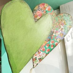 The floating heart kites in the window make me smile! This is the finished heart from yesterday's how to video. The larger one in back is decoupaged and finished with #anniesloan #craqueleur and #blackwax. And, the color is inspired by the 2017 Pantone co