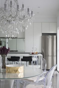 Crystal chandelier + ghost chair in modern kitchen