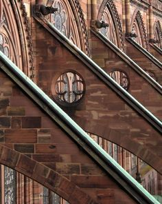 Strasbourg, Alsace, France Quatrefoil, or 4 leaf clover, are typical Christian and medieval symbols carved  in the buttresses.