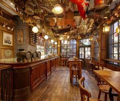 London is famous for having some of the best pubs and with very good reason. With so many to choose from, though, check out Time Out's guide to London boozers to steer you in the right direction. Pub Design, Tile Design, Literary Themes, Pub Interior, Interior Design, Best Pubs, Pub Decor, Old Pub, Around The World In 80 Days