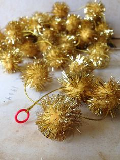 Vintage Metallic Gold Tinsel Pom Pom Garland by Museandmiscellany