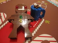 gingerbread man and hot chocolate Lego Advent, Lego News, Gingerbread Man, Hot Chocolate, Table Lamp, Board, Fun, Crockpot Hot Chocolate, Table Lamps