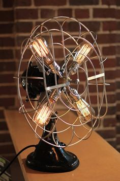 Vintage Fan Lamp by DanCordero is an elegant upcycle design lamp that's made using an old fan and Vintage Edison Style Bulbs. Objects from back in the old days Lamp Design, Steampunk Lamp, Upcycle Design, Cool Lighting, Lamp, Creative Lighting, Vintage Fan Lamp, Vintage Lighting, Vintage