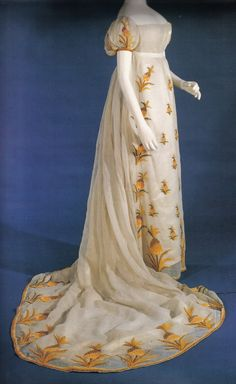 A dress for Eloise, heroine of To Sir Phillip, With Love by Julia Quinn. She would have loved the exotic floral motif--a lovely nod toward her botanist husband. Crewel-embroidered Empire-era muslin dress.