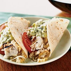 Fish Tacos with Creamy Lime Guacamole and Cabbage Slaw:        Fish tacos are a staple among California surfers but are often beer-battered and fried. Kerry Simon's healthier, grilled version enriches the guacamole with low-fat sour cream. [click for recipe]